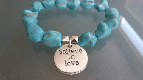 "Turquoise Howlite Nuggets accented with a ""believe in love"" Silver plater charm."