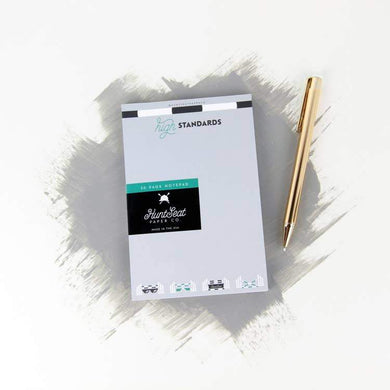WHITE NOTEPAD WITH THE TEXT