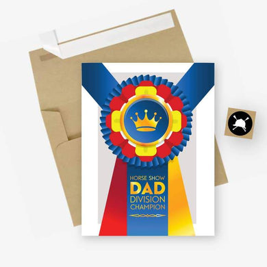 WHITE CARD AND BROWN ENVELOPE. CHAMPION RIBBON WITH HORSE LOGO AND LABELED HORSE SHOW DAD DIVISION CHAMPION