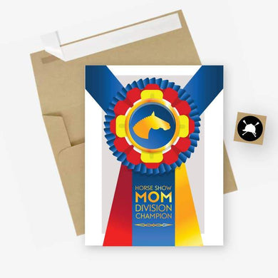 WHITE CARD AND BROWN ENVELOPE. CHAMPION RIBBON WITH HORSE LOGO AND LABELED HORSE SHOW MOM DIVISION CHAMPION