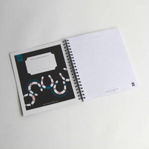 INTERIOR OF NOTEBOOK THAT HAS A HORSESHOE DECORATED PAGE WITH PERSONAL NOTES SPACE AND LINED PAGES