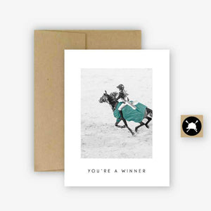 WHITE CARD WITH BROWN ENVELOPE. BLACK AND WHITE PICTURE OF GIRL RIDER AND GREEN SHOW COOLER