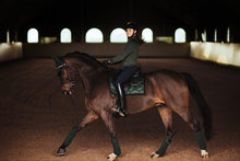 Load image into Gallery viewer, equestrian stockholm dressage saddle pad - deep olivine rider on bay horse