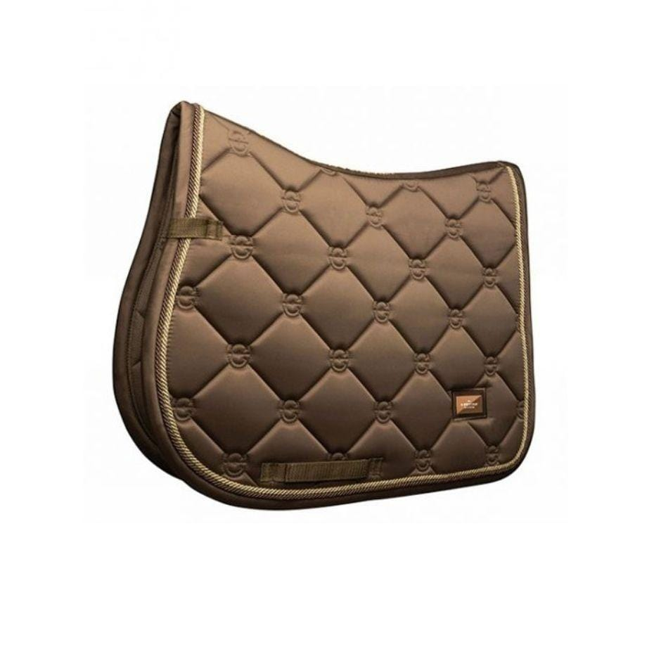 Close contact saddle pad in a champagne colored satin. Gold and brass chording borders the edges of the pad