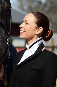 white satin stock tie with black accent and crystals on a woman in the show ring