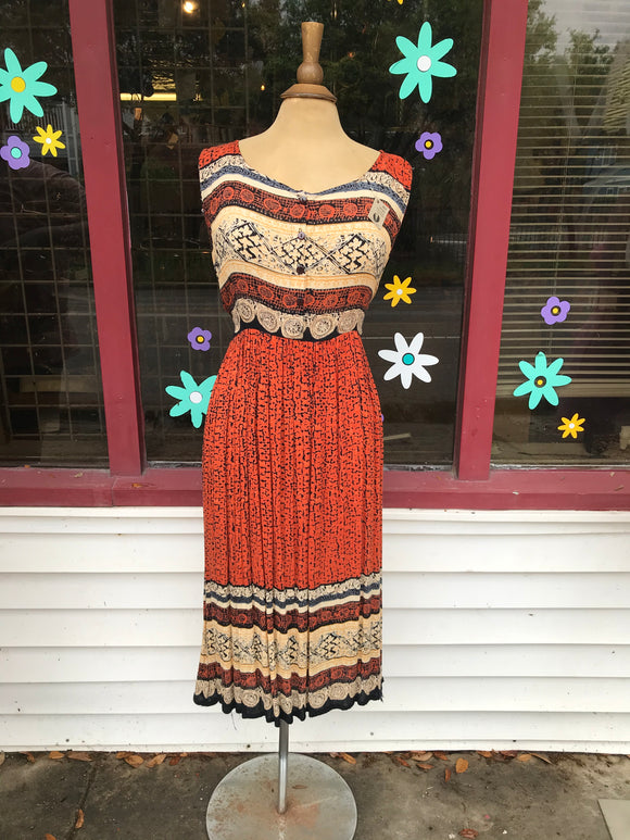 Orange tribal midi dress.