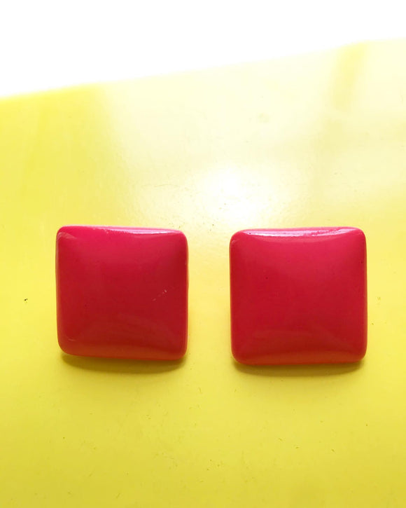 1980s hot pink square clip on earrings.