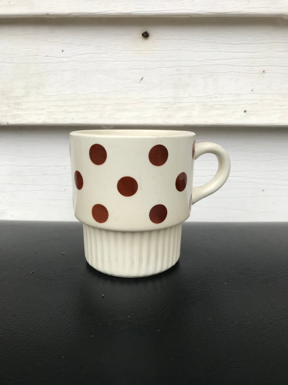 Brown polka dot coffee mug.