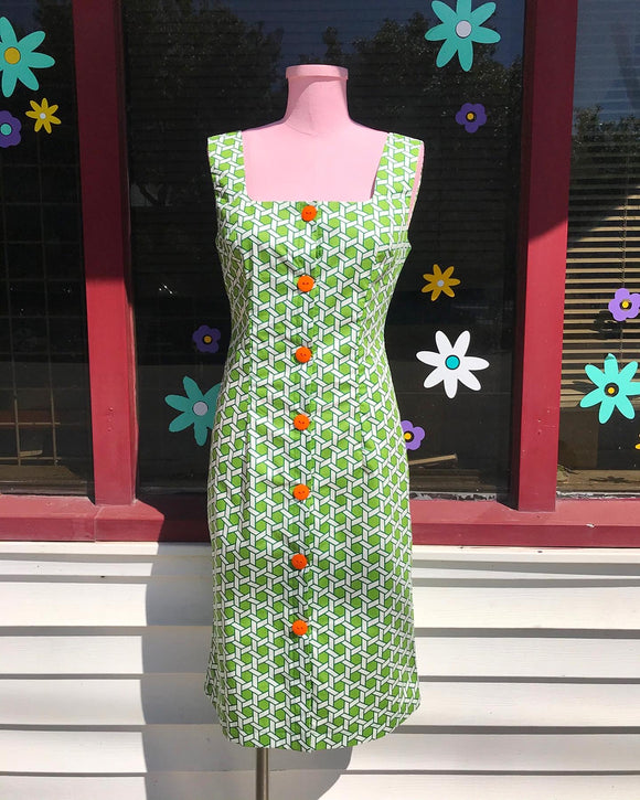 60's Inspired Lattice Green & White button front sheath dress  w/orange buttons.⁣