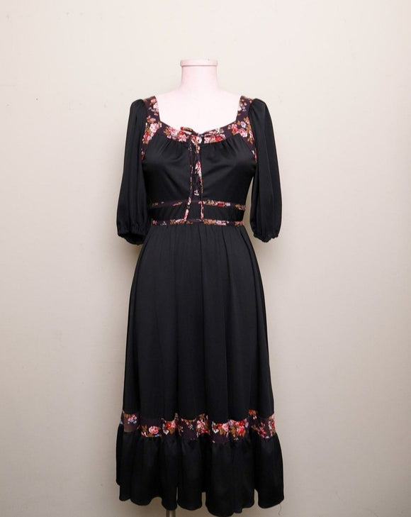 1970's Black prairie style puff sleeve dress with floral trim and corset lacing on bodice