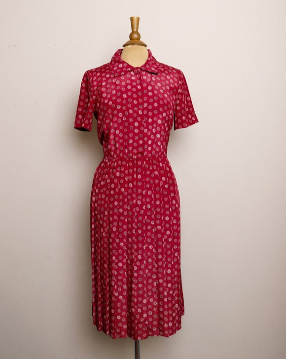 1990's Raspberry pleated dress with a circle swirl print and scallop collar