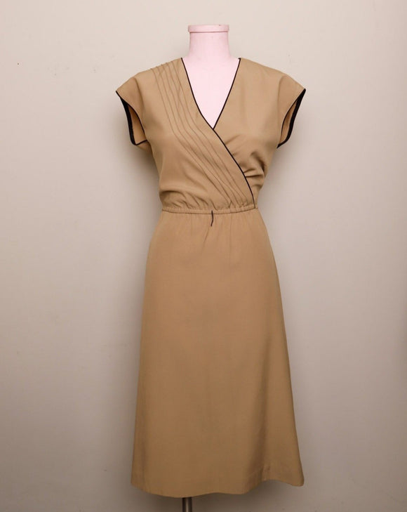 1970's Sleeveless Tan A-line dress with a faux wrap bodice and black trim detail