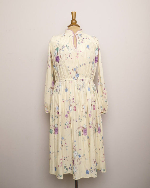 1970's Sheer Ivory accordion pleated long sleeve dress with purple & blue florals and mandarin collar key hole