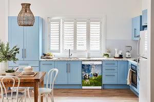 Breakfast table in kitchen with white walls, blue cabinets, marble countertop large window over sink area grazing cows magnet skin on dishwasher white control panel