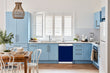 Load image into Gallery viewer, Breakfast table in kitchen with white walls, blue cabinets, marble countertop large window over sink area midnight blue magnet skin on dishwasher white control panel