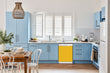 Load image into Gallery viewer, Breakfast table in kitchen with white walls, blue cabinets, marble countertop large window over sink area school bus yellow magnet skin on dishwasher white control panel