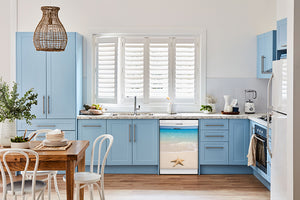 Breakfast table in kitchen with white walls, blue cabinets, marble countertop large window over sink area starfish on beach magnet skin on dishwasher white control panel