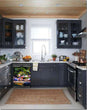 Load image into Gallery viewer, Dark Gray Kitchen Cabinets with White Marble Countertop Against White Walls Window Behind Sink Flamingo Garden Magnet Skin on Dishwasher Black Control Panel