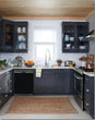 Load image into Gallery viewer, Dark Gray Kitchen Cabinets with White Marble Countertop Against White Walls Window Behind Sink Gloss Black Magnet Skin on Dishwasher Black Control Panel