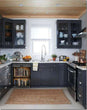 Load image into Gallery viewer, Dark Gray Kitchen Cabinets with White Marble Countertop Against White Walls Window Behind Sink Vintage Books Bookcase Magnet Skin on Dishwasher Black Control Panel