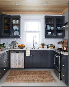 Dark Gray Kitchen Cabinets with White Marble Countertop Against White Walls Window Behind Sink White  Oak Wood Magnet Skin on Dishwasher Black Control Panel