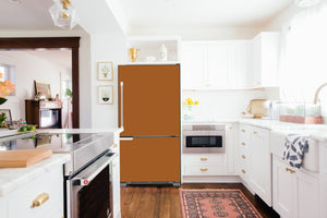 Full Kitchen Layout Wood Floors Metal Copper Magnet Skin on Refrigerator Model Type Bottom Freezer Next to Recessed Microwave Surrounding White Cabinets and White Countertop