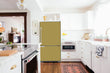 Load image into Gallery viewer, Full Kitchen Layout Wood Floors Olympic Gold Magnet Skin on Refrigerator Model Type Bottom Freezer Next to Recessed Microwave Surrounding White Cabinets and White Countertop