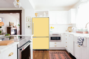 Full Kitchen Layout Wood Floors Vanilla Cream Magnet Skin on Refrigerator Model Type Bottom Freezer Next to Recessed Microwave Surrounding White Cabinets and White Countertop