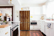 Load image into Gallery viewer, Full Kitchen Layout Wood Floors Weathered Wood Magnet Skin on Refrigerator Model Type Bottom Freezer Next to Recessed Microwave Surrounding White Cabinets and White Countertop
