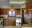 Load image into Gallery viewer, Kitchen Brown Wood Cabinets Recessed Stove & Oven Chickens on the Run Magnet Skin on Dishwasher White Control Panel Next to Sink
