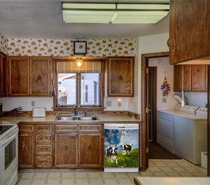 Kitchen Brown Wood Cabinets Recessed Stove & Oven Grazing Cows Magnet Skin on Dishwasher White Control Panel Next to Sink