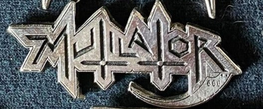 Mutilator Metal Badge