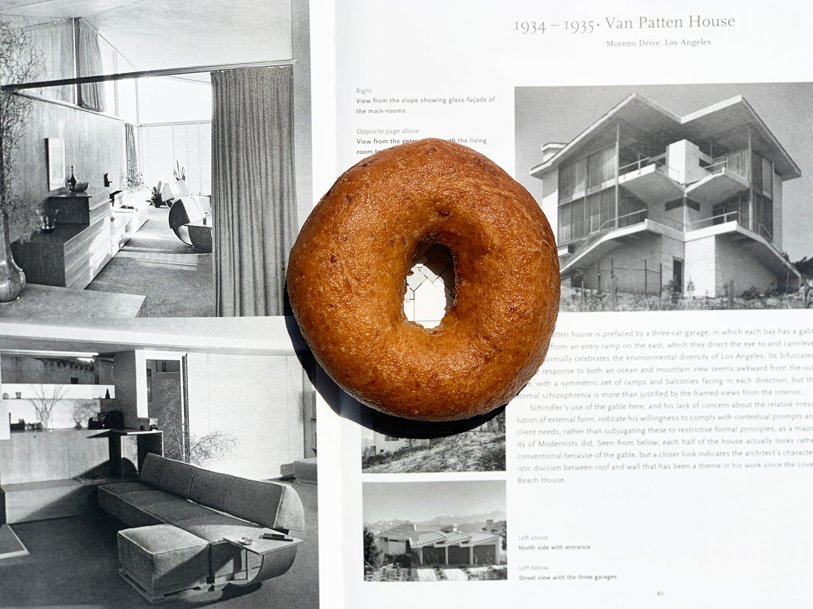 Gluten-free bagel displayed on a book about architecture - GFY Kitchens