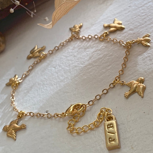 Tiny Birds and Bees Charm Bracelet in Gold and Brass