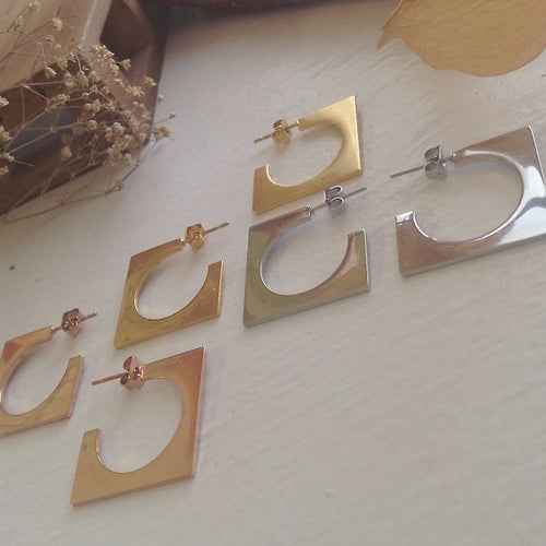 Mid-century, cubist hoop earrings in gold, silver and rose gold