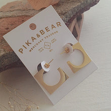 Load image into Gallery viewer, Mid-century cubist hoop earrings in gold on gift card