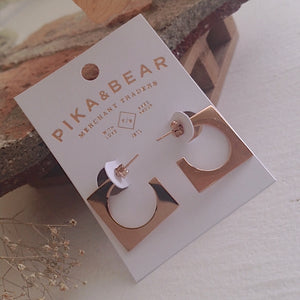 Mid-century cubist hoop earrings in rose gold on gift card