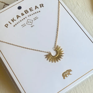 Tiny Sunburst Charm Necklace in Gold on Gift Card