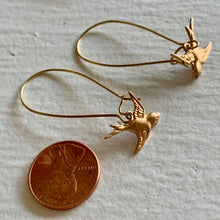 Load image into Gallery viewer, Swooping brass sparrow charms on kidney wire drop earrings