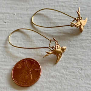 Swooping brass sparrow charms on kidney wire drop earrings