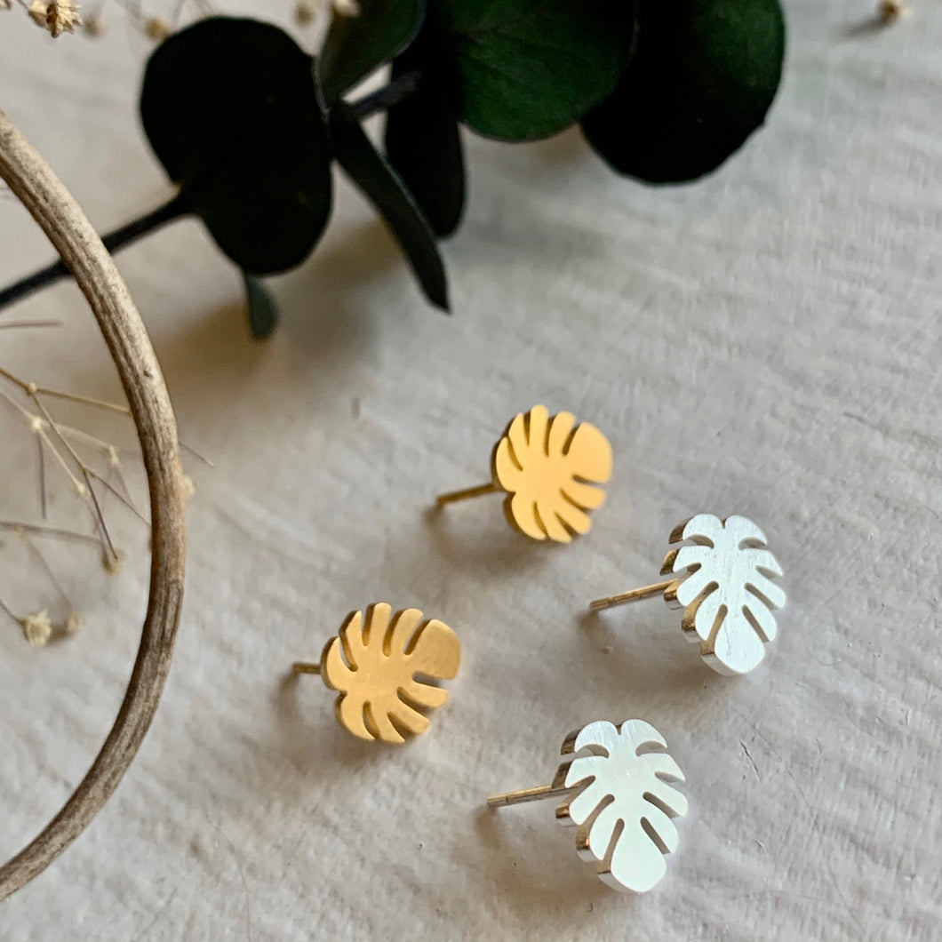 Tiny monstera leaf stud earrings in gold and silver