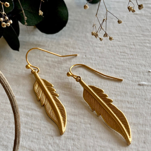 Raw brass and gold bohemian feather drop earrings