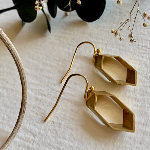 Sliced hexagonal drop earring modernist design in raw brass