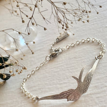Load image into Gallery viewer, Swooping swallow bracelet in antiqued silver and raw brass