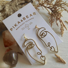 Load image into Gallery viewer, Abstracted human face Picasso inspired design drop earrings in raw brass