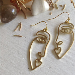 Abstracted human face Picasso inspired design drop earrings in raw brass