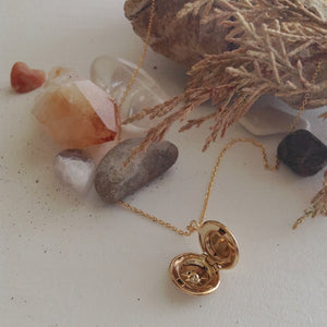 Gold Starburst Charm Locket Necklace