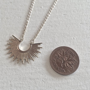 Tiny Sunburst Charm Necklace in Silver