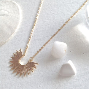 Tiny Sunburst Charm Necklace in Gold
