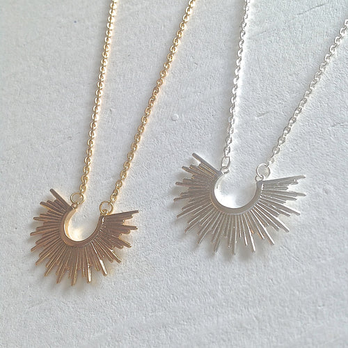 Tiny Sunburst Charm Necklace in gold and silver